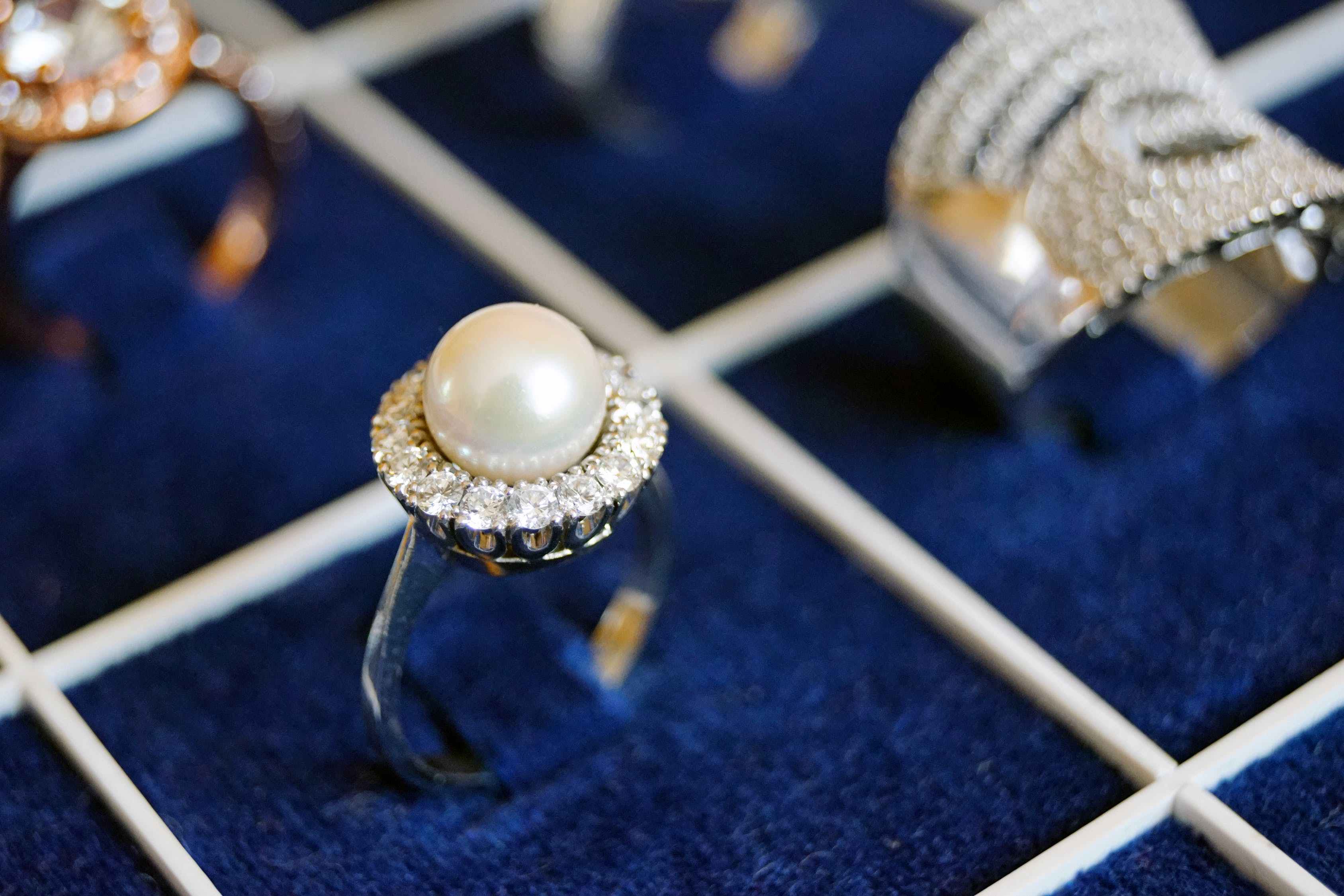 White Pearl Ring on Blue Surface