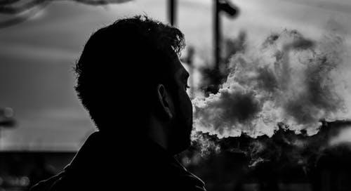 Grayscale Photography of Man Smoking