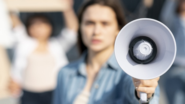 Macintosh HD:Users:vincentcolistro:Downloads:activist-woman-protesting-with-megaphone_23-2148296478.jpg