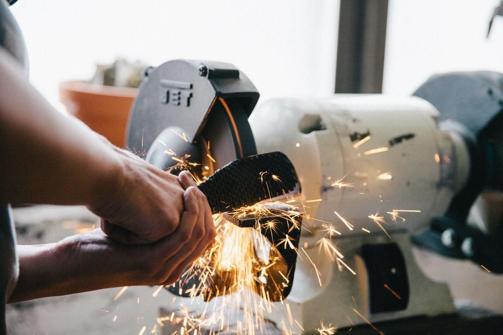 person welding steel