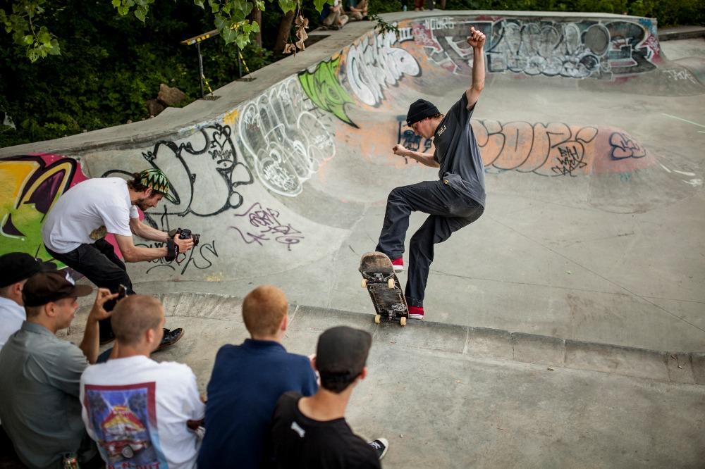 A skateboarder skating a halfpipe