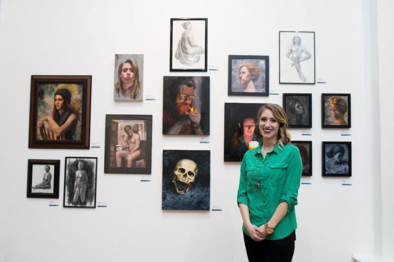 woman with art exhibit