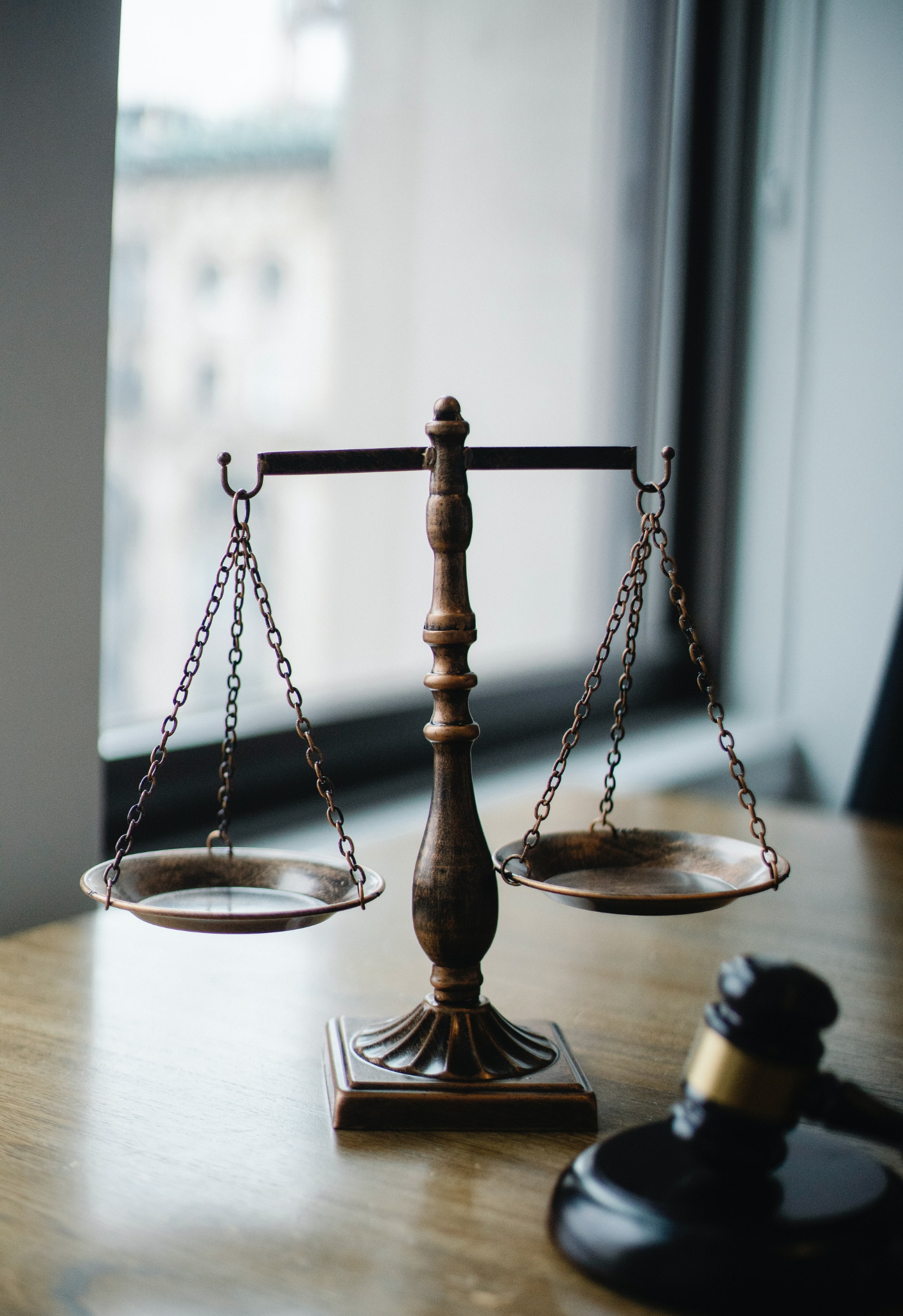A scale and gavel representing the law.