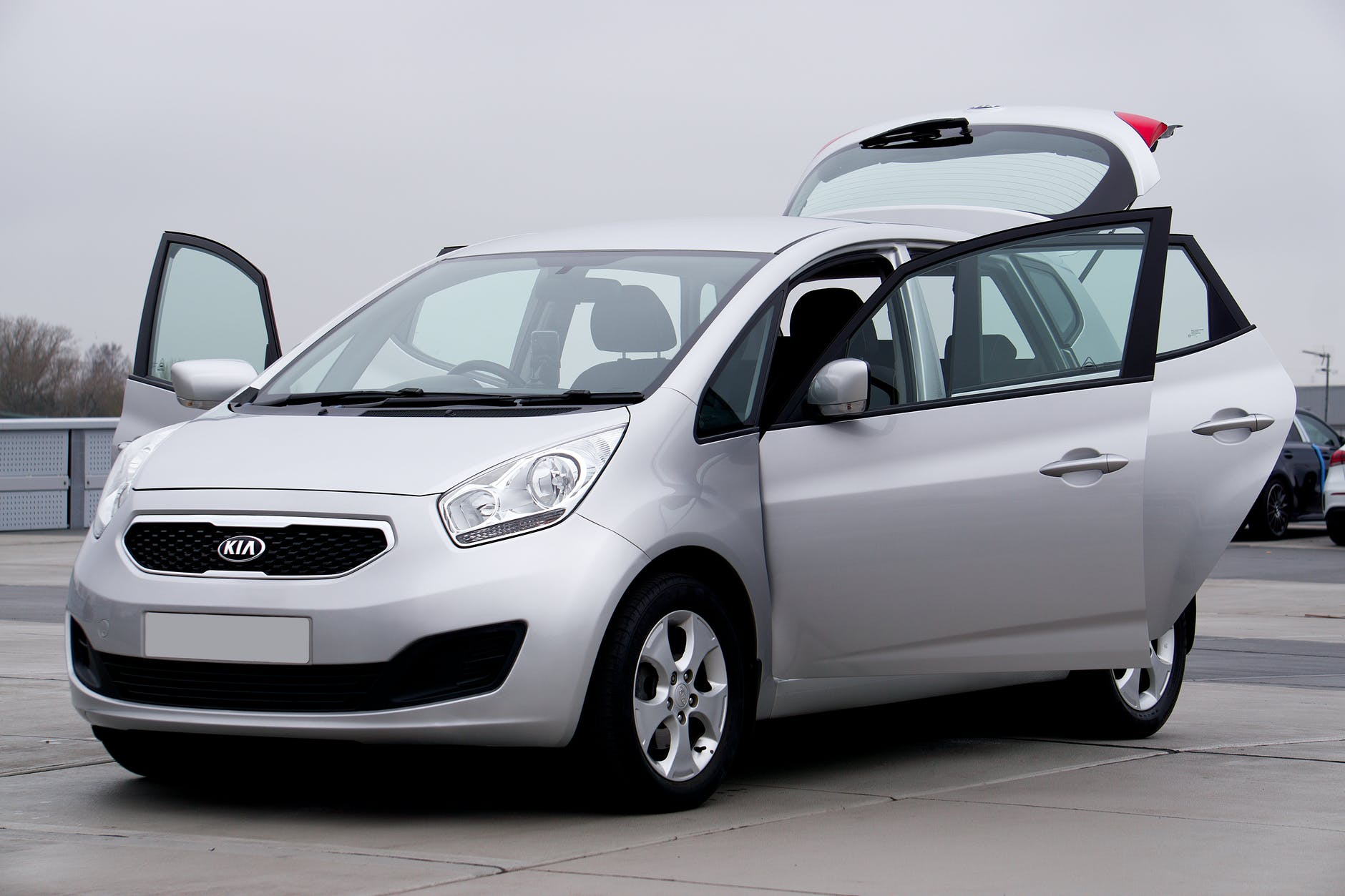 A KIA vehicle with all doors open at one of the demo cars for sale Brisbane dealerships yard