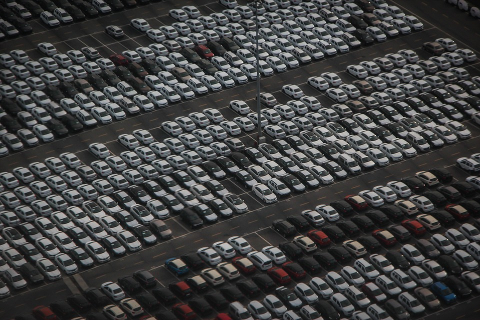 Multiple rows of demo vehicles at a dealership