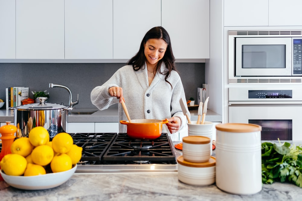 woman cooking inside kitchen room