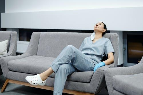 Photo Of Woman Resting On The Couch